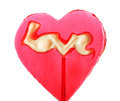 Red sweet lollipop in the shape of a heart on a stick Royalty Free Stock Photos