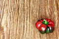 Red sweet pepper on grunge wooden background taken closeup. Royalty Free Stock Photo