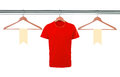 Red t-shirts on hangers and blank tags isolated on white backgro Royalty Free Stock Photo