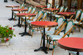 Red tabes elegant restaurant tables with chairs placed outdoors Royalty Free Stock Photography