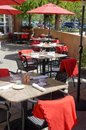 Red tables and chairs in outdoor restaurant Stock Photo