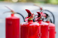 Red tank of fire extinguisher Royalty Free Stock Photo