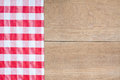 Red tartan cloth on wood a a background Stock Photography