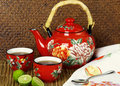 Red Teapot With Cups Of Tea Stock Photography