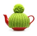 Red teapot in green hat isolated Royalty Free Stock Photo