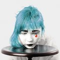 Red tear clown makeup girl with blue hair and Royalty Free Stock Images