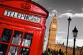 Red telephone booth and big ben in london england the uk the symbols of on black on white sky Royalty Free Stock Photos