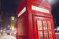 Red telephone booth and big ben in london at night Stock Photos
