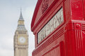 Red telephone booth and big ben in london street Royalty Free Stock Photos
