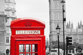 Red telephone booth and big ben in london street Royalty Free Stock Image