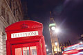 Red telephone booth and big ben in london street at night Stock Photo