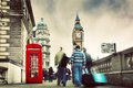 Red telephone booth and big ben in london uk england the people walking rush the symbols of vintage retro style Royalty Free Stock Photography