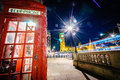 Red Telephone Booth and Big Ben at night Royalty Free Stock Photo
