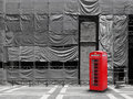 Red telephone booth canvas background construction site scaffold tarpaulin Royalty Free Stock Images