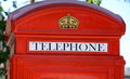 Red telephone booth close up retro style Royalty Free Stock Photography