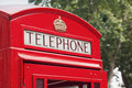 Red telephone booth in london street day time Royalty Free Stock Images