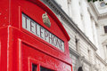 Red telephone booth in london street day time Royalty Free Stock Photography