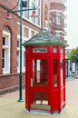 Red telephone booth at the street in christchurch new zealand Stock Photography
