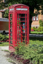 Red telephone booth typical english in town of mount royal montreal quebec canada Royalty Free Stock Image