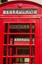 Red telephone booths next to each other with multiple patterns Royalty Free Stock Images