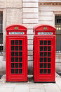 Red telephone booths traditional in london Stock Images