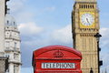 Red Telephone Box with the Clock Tower of Big Ben in London Royalty Free Stock Photo