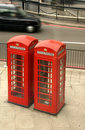 Red telephone boxes and black taxi Stock Images