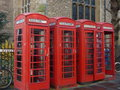 Red telephone boxes line of four in cambridge uk Stock Photos