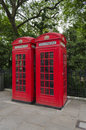 Red telephone boxes a pair of typical english booths Royalty Free Stock Image