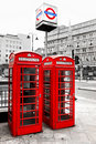 Red telephone boxes and underground logo, London, Royalty Free Stock Photos