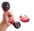 Red telephone handset in hand Royalty Free Stock Photo