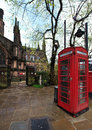 Red telephone kiosk in old part of Chester Royalty Free Stock Images