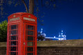 Red telephone and Tower Bridge at night, London, England Royalty Free Stock Photo