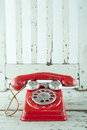 Red telephone on wooden chair Royalty Free Stock Photo