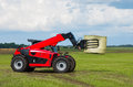 Red telescopic handler in the lithuanian fields Royalty Free Stock Photos