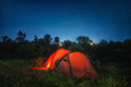 Red tent lighting inside under night sky star Stock Photography