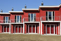Red terraced house front view of a newly built waiting for its residents Royalty Free Stock Photography