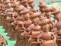 Red terracotta human figures series of similar wearing big indian turbans Stock Photo