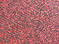 Red textile background full format view of fine checkered fabric in and black Royalty Free Stock Photos