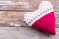 Red textile heart on wooden background close up Royalty Free Stock Photos