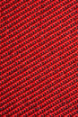 Red textural fabric, pattern on diagonal Stock Image