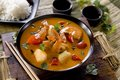 Red thai curry closeup of a bowl of with scallops shrimp and vegetables Stock Photo