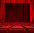 Red theater or cinema curtain or drapes with seats Royalty Free Stock Images
