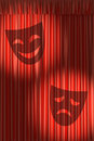 Red theater curtain with shadow of masks gathers under two round spot lights Stock Photo