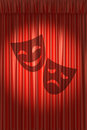 Red theater curtain with shadow of two masks gathers under round spot light Stock Photos