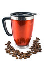 Red thermos with coffee beans Stock Photography