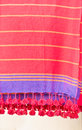 Red throws colorful hanging in a store Stock Photos