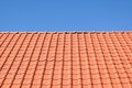 Red tile roof against blue sky Stock Images