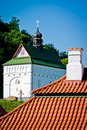 Red tile roof and church Stock Photos
