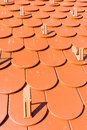 Red tile roof detail of modern with snow guards Royalty Free Stock Images